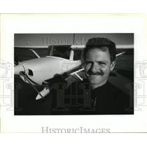 1991 Press Photo Douge Banquer with Cesna model 150m plane he is learning to fly