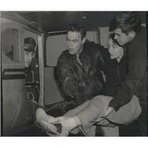 1950 Press Photo Daniel Petersen & Jack Williams Placing Myrna Landon in Plane
