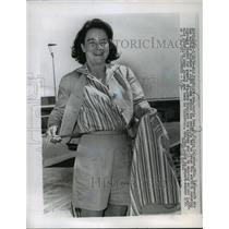 1966 Press Photo Mrs. Jerrie Mock Showing Clothes She'll Wear For Her World-Trip