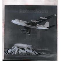 1954 Press Photo A Boeing 707 US jet transport over Mt Rainier in WA - neo16256