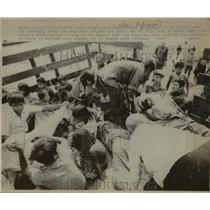 1975 Press Photo Injured Cambodians after Attack, Chrouy Changvar, Cambodia