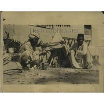 1924 Press Photo Men with a mango tree covered to help it grow - neo11007