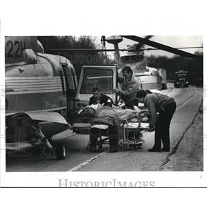 1991 Press Photo Woman injured lifted into a Metro Life Flight Helicopter.