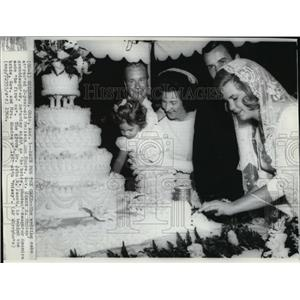 1966 Wire Photo Melissa's attention in weddingcake while Saundra makesfirst cut