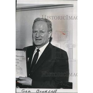 1963 Press Photo Geo Brunzell receives award from William P. Weaver - spa01803