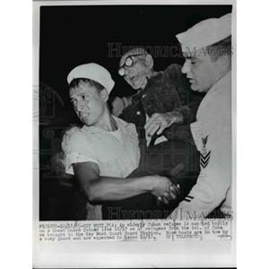 1965 Press Photo Elderly Cuban Refugee is carried bodily from a Coast Guard Boat