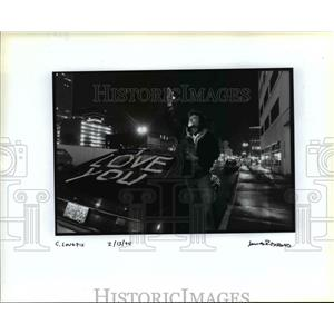 1994 Press Photo Man Writes I Love You on Car for Valentine's Day - orb56562