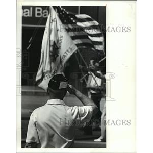 1980 Press Photo A VFW member salutes a passing flag in the parade. - cvb71790
