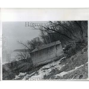1966 Press Photo A family swimming pool undermined by erosion, slides to beach