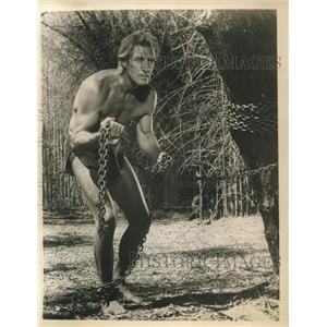 "Press Photo Jock Mahoney in jungle adventure ""Tarzan Goes to Indian""."