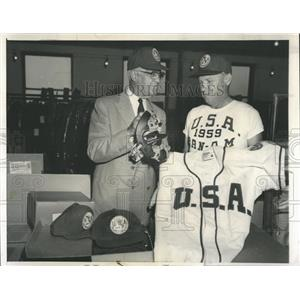1959 Press Photo Harridge Inspects Baseball Equipment - RRW52029