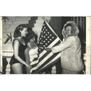 1958 Press Photo Jack Diabo adds a star to Old Glory. - RRX85187