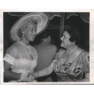 Press Photo columnist Louella Parsons greets Betty Hutton at her party