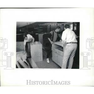 1994 Press Photo technicians work on construction of Midwest Express in Omaha