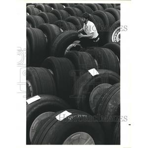 1988 Press Photo Goodyear Technician Moves Aircraft Tires To Retreading Line