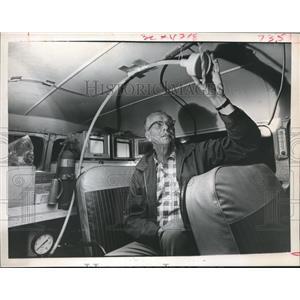 1966 Press Photo Bill Hafenbritle Checks Tube for Air Pollution In Truck-Houston