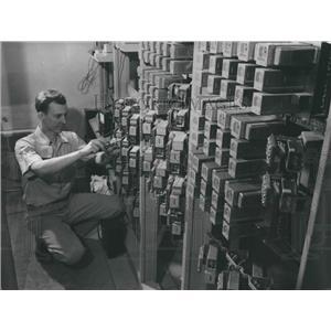 1956 Press Photo Richard Schneider Installs Phone Equipment at Mitchell Field