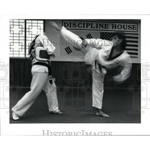 1990 Press Photo Joe Kim sweeps a kick over Mike Mignona 's head - cvb35547