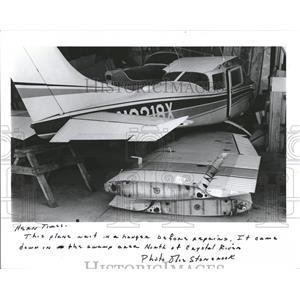 1986 Press Photo plane waits repairs hanger swamp area