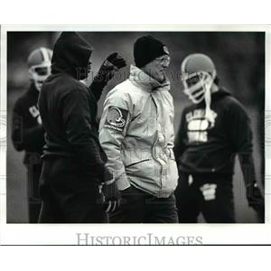 1987 Press Photo Marty Schottenheimer watches the Browns warm up for practice.