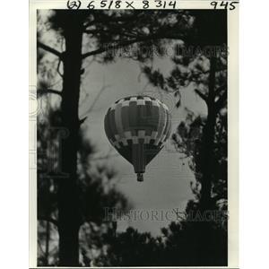 1980 Press Photo Hot Air Balloon Over Forest in Covington, Louisiana - noa25127