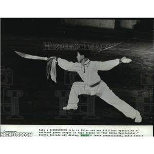 1981 Press Photo A boy performs in a sword competition in China - spb05690