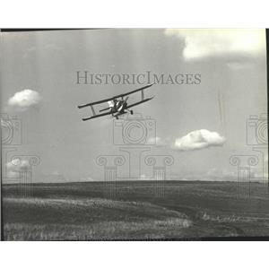 1979 Press Photo Crop-duster flying over an open field - spb07665
