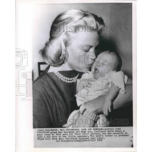 1959 Press Photo Actress Joan Caulfield with new son, Caulfield Kevin Ross.