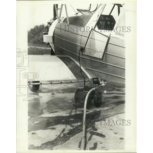 1981 Press Photo Crop duster plane filled with pesticide for spraying