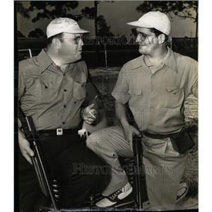 1941 Press Photo Two Men Riffles Talking Overby Sattler - RRX69941