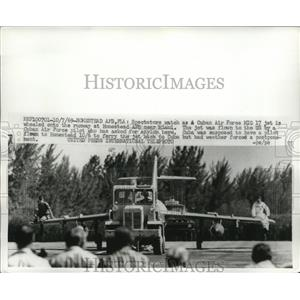 1969 Press Photo Spectators watch Cuban Air Force MIG 17 Jet Wheeled on Runway