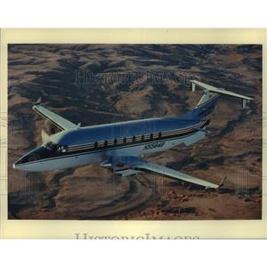 Press Photo A Beech 1900D plane, 19-passenger twin-engine aircraft in flight