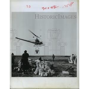 1969 Press Photo Helicopter prepares to spread fertilizer on Alaska's tundra