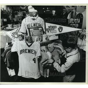 1983 Press Photo Young lad checks out Milwaukee Brewers merchandise for sale