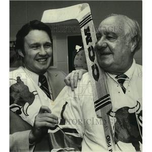 1977 Press Photo Birmingham AL businessman Tom Bradford & man, with hockey stick