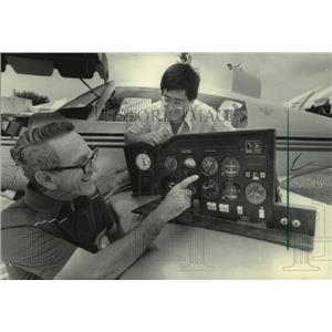 1983 Press Photo Tom Zompolas & son display Pamco system controls at airshow, WI