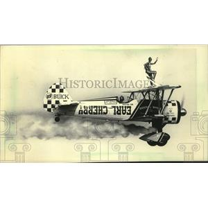 1984 Press Photo Paula Cherry on the wing of a plane at Fly-in, Wisconsin
