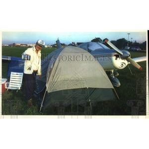 1993 Press Photo Carl Rodgers bails water from tent at Whittman Airport