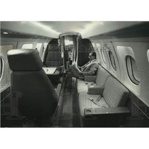 1972 Press Allen K. Pepin, Vice President of Sales, relaxing in cabin of BH-125