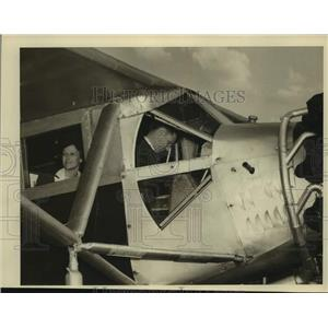 Press Photo Mr. and Mrs. Douglas Corrigan inside plane in the air - saa07045