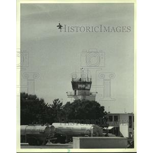 1988 Press Photo Blue Angel plane flies over airport in Alabama - amra05827