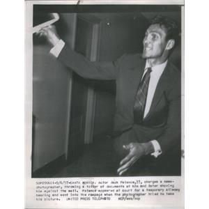 1957 Press Photo Paparazzi Actor Jack Palance - RSC93325