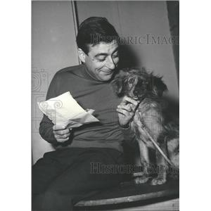 1957 Press Photo French screen and stage actor,Francois Perier and a dog