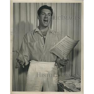 Press Photo actor Hugh O'Brian, star of The Life and Legend of Wyatt Earp, sings