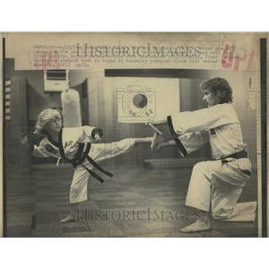1976 Press Photo Little Karate Boy Kick Breaks Board - RRT24057