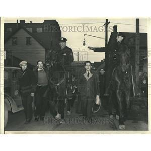 1941 Press Photo Mounted policemen escort man from work