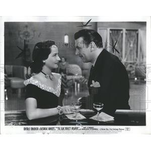 1940 Press Photo Merle Oberon Flirts With George Brent - RRS05119