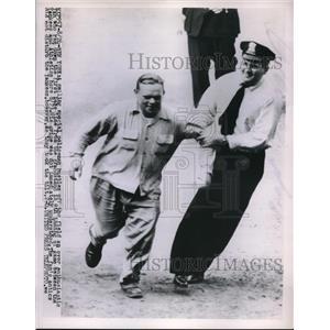 1953 Press Photo Smiling Policeman Hustles Fan Off Field at Yankees Game