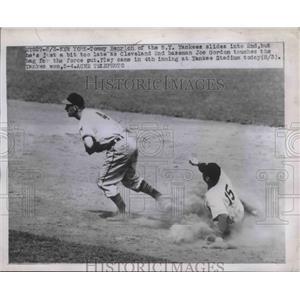 1947 Press Photo Tommy Henrich of Yankees Slides, Joe Gordon of Cleveland
