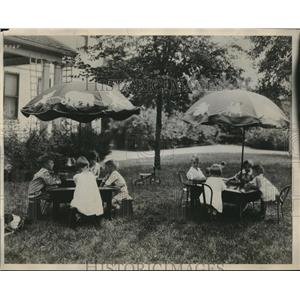 1931 Press Photo of Privileged Young Boys and Girls Playing Bridge Outside